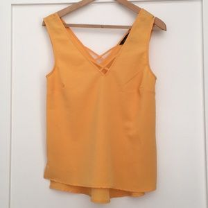 Orange top with cute detail
